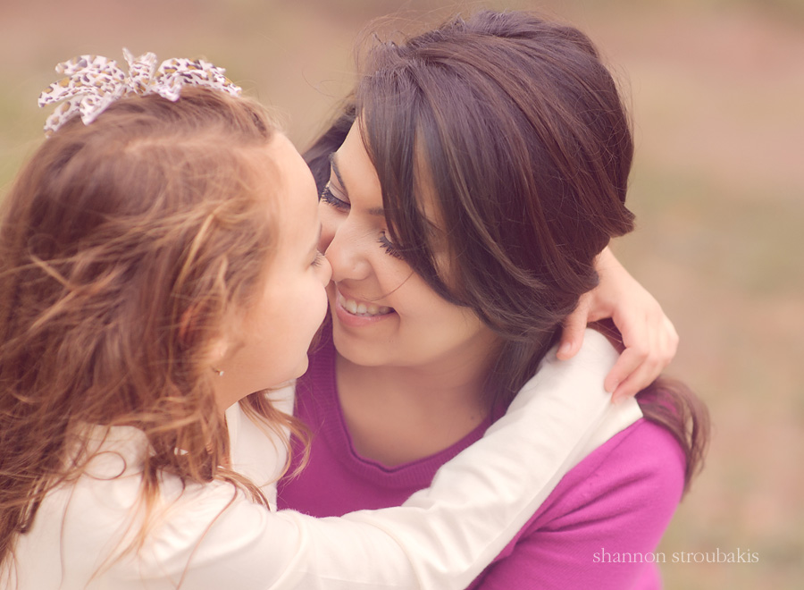 lifestyle emotive portrait of a mother and a daughter rubbing noses